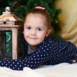 The little girl at christmas fur-tree — Stock Photo