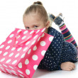 Little girl with packages — Stock Photo #35247427