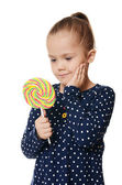 The little girl with lollipop — Stock Photo