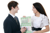 The businessman and businesswoman hold calendar — Stock Photo