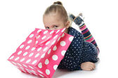 Little girl with a packages — Stock Photo