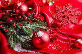 New Year's spheres on red fabric — Stockfoto