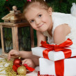 The little girl at a Christmas fur-tree with gifts — Stock Photo #37434173