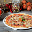 The Italian pizza with a ham and mushrooms — Stock Photo