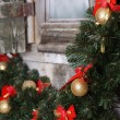 Christmas branch of a fur-tree on a wall — Stock Photo