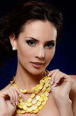 The beautiful woman in expensive pendant — Stok fotoğraf