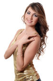 A beautiful sensual woman in a gold dress — Stock Photo