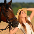 The woman on a horse in the field — Stock Photo #41005673