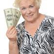 The elderly woman with dollars — Stock Photo