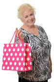 The elderly woman with a package — Stock Photo