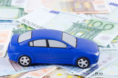 The toy car for euro banknotes as a background — Stock Photo