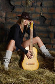The woman with guitar on hay — Stock Photo