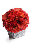 Bouquet of beautiful flowers in basket — Stock Photo
