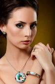 The beautiful woman with expensive jewelry — Foto de Stock