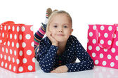 The little girl with a two packages isolated — Stock Photo