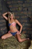 The woman in bikini on hay at a wall — Stock Photo