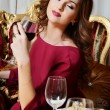 Woman with a wine glass — Stock Photo