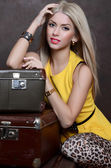 Woman with retro suitcases — Stock Photo