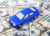 Toy car for dollar banknotes — Stock Photo