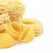 Italian pasta tagliatelle nest isolated on white background — Stock Photo #42403147