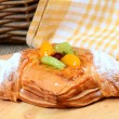 Roll from flaky pastry with fruit — Stock Photo #42403153