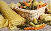 Raw colored pasta fusilli sa a background — Stock Photo