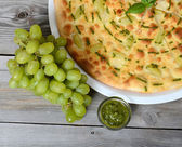 Focaccia with grapes and sauce Pesto — Stock Photo