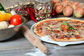The Italian pizza with olives and a salami — Stock Photo
