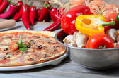 The Italian pizza with olives and salami — Stock Photo