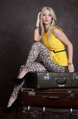 The beautiful woman with old suitcases — Stock Photo