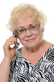 Woman speaks on phone — Stock Photo