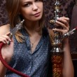 The beautiful woman with a hookah — Stock Photo