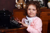 The little girl in vintage interior — Foto de Stock