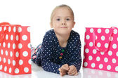 The little girl with a two packages isolated — Stockfoto