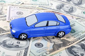 Car and dollar banknotes — Stock Photo