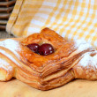 Roll from flaky pastry with cherry — Stock Photo #47788531