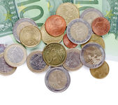 Various Euro currency bills and coins — Stock Photo