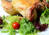 Baked hen with salad — Stock Photo