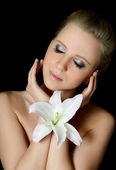 Woman with lily flower — Stock Photo
