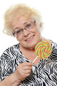 Elderly woman with candy — Foto Stock