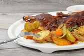 Half duck with potato, apples and pineapple — Stock Photo