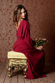 Woman in  claret dress — Stock Photo