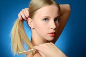 Girl brushes hair — Stock Photo