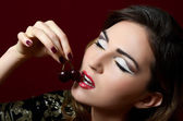 Woman with sweet cherry — Stock Photo