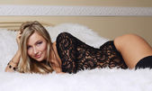 Beautiful girl   on bed — Stock Photo