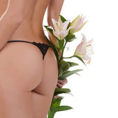 Female buttocks with  lily — Stock Photo