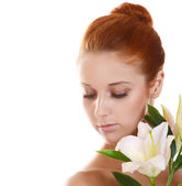 Girl with pink lilies — Stock Photo