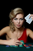 Woman with casino chips — Stok fotoğraf