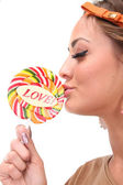 Image of sexy girl kisses a candy — Stock Photo