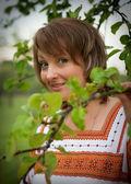 Woman in her garden vnatsionalnom suit — Stock Photo